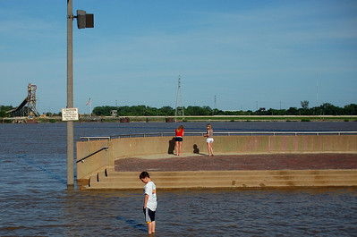 The swollen banks of the Mississippi in May 2011 overwhelm the Jefferson National Expansion Memorial park. St. Louis, Mo.